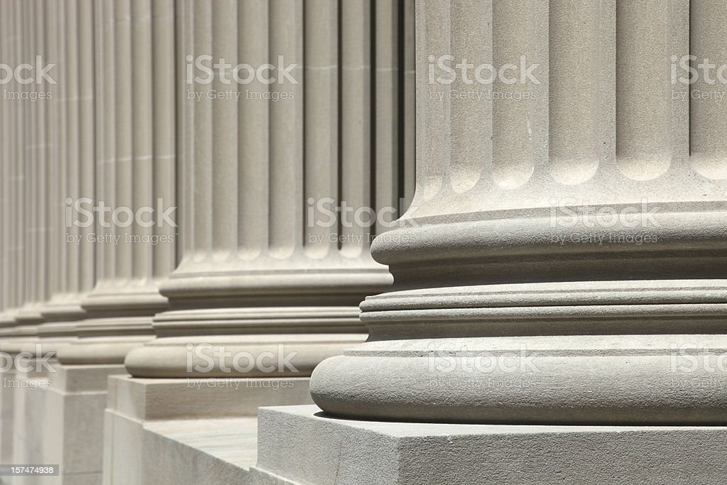 Low angle view of perfect white columns royalty-free stock photo