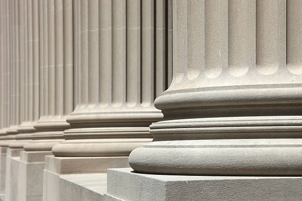 Low angle view of perfect white columns stock photo