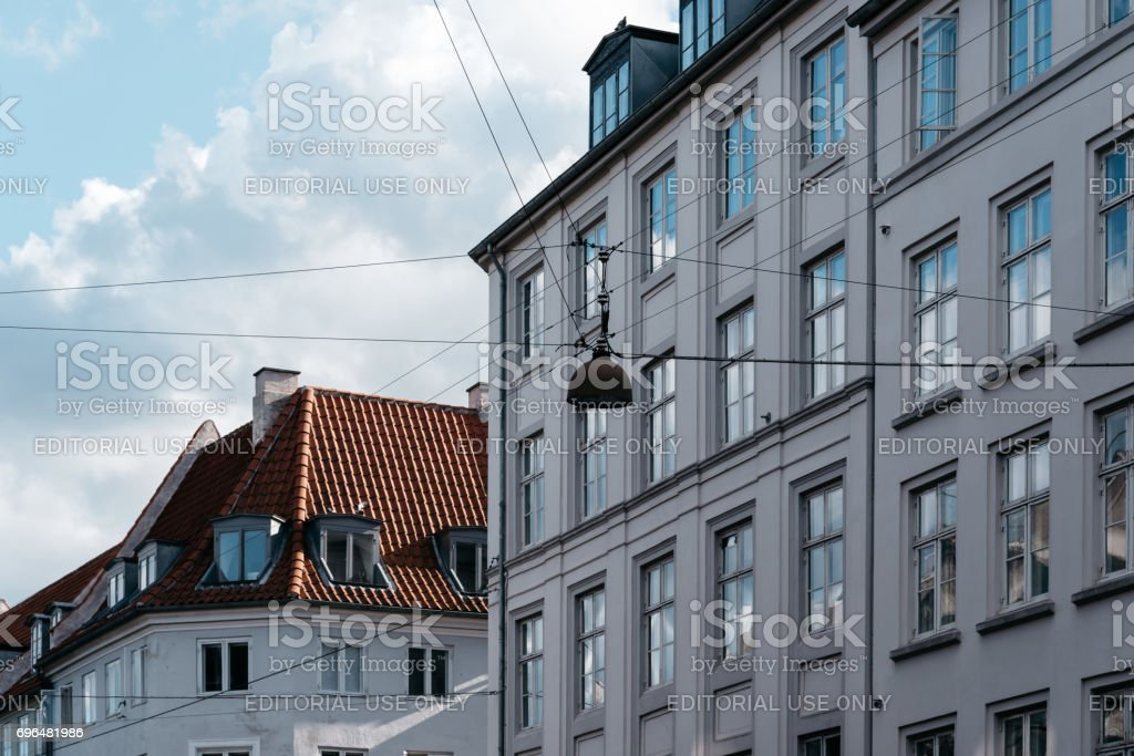 Low angle view of residential building in historical city centre of Copenhagen a sunny day of summer stock photo