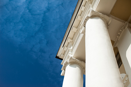 Low angle view of sky and columns Architectural Column Against clear Blue Sky