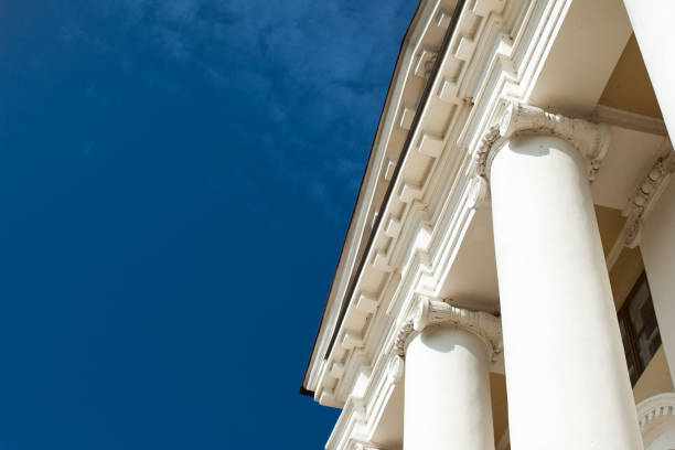 Low angle view of sky and columns Architectural Column Against clear Blue Sky sunny day Low angle view of sky and columns Architectural Column Against clear Blue Sky neo classical stock pictures, royalty-free photos & images