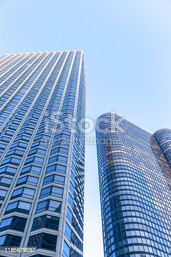 Low angle view of skyscraper towers against blue sky