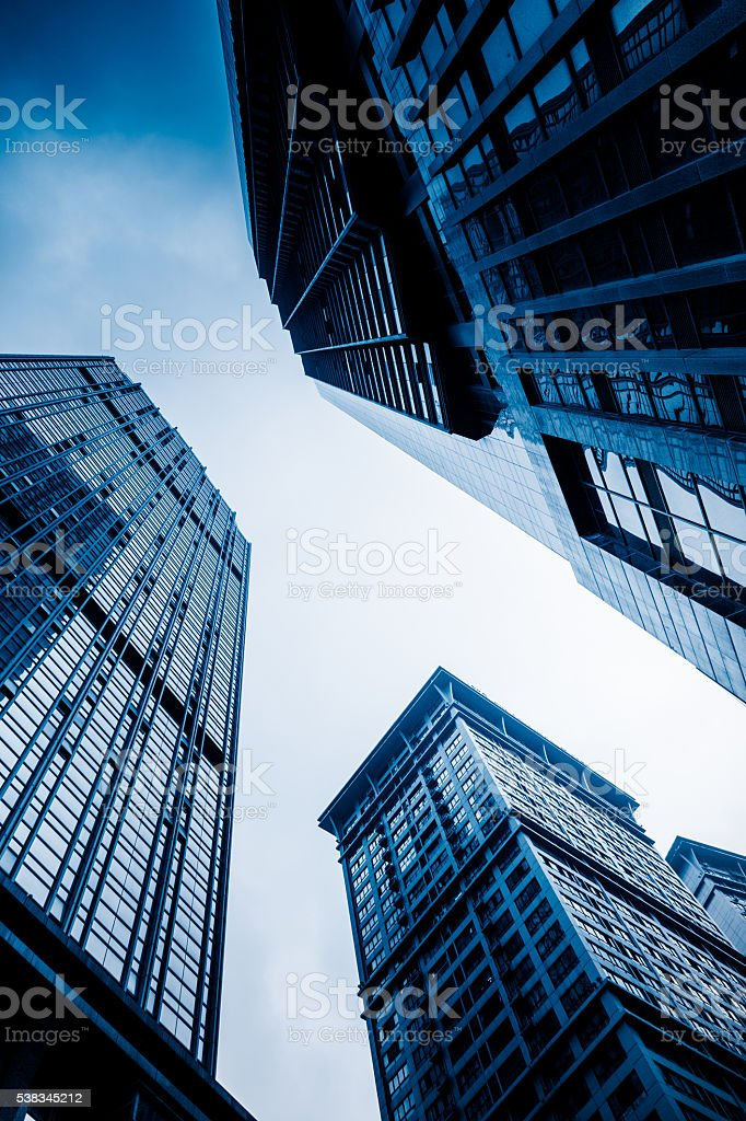 low angle view of skyscrapers of chongqing city,china,blue toned...