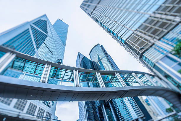 low angle view of skyscrapers of hong kong central district low angle view of skyscrapers of hong kong central district,bank of china tower,china,asia. footbridge stock pictures, royalty-free photos & images