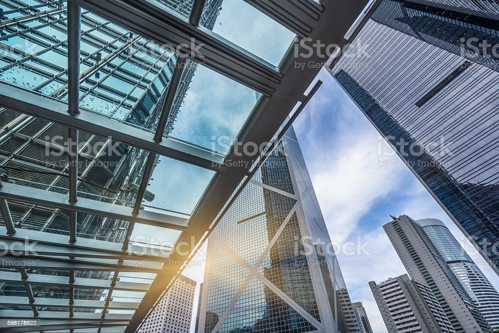 low angle view of skyscrapers through glass canopy foto royalty-free