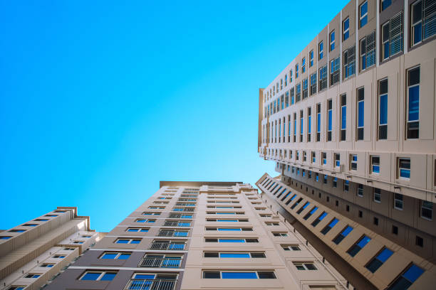 Low angle view of the apartment building against blue sky stock photo