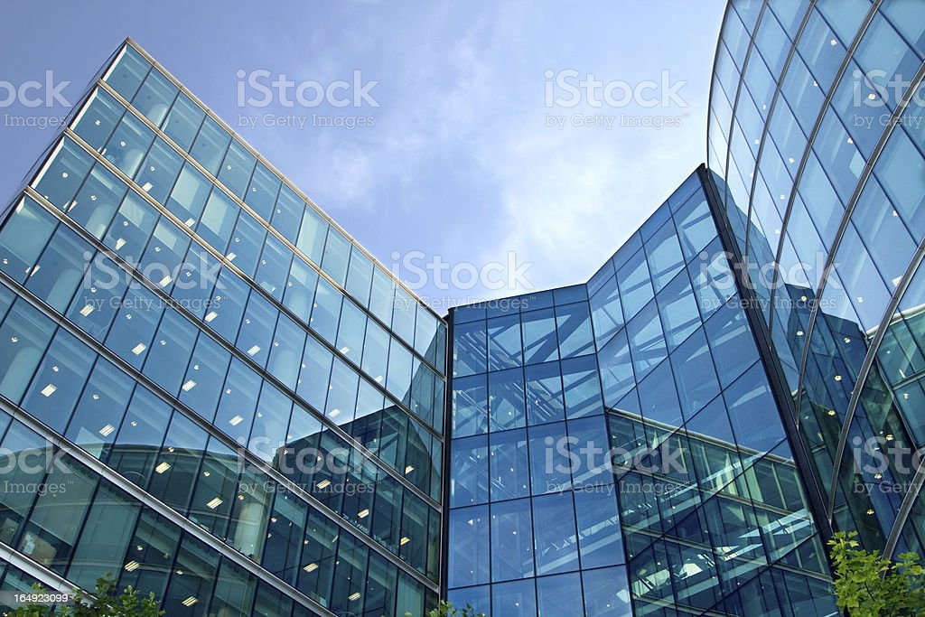Low angle view of the exterior of a corporate glass building royalty-free stock photo