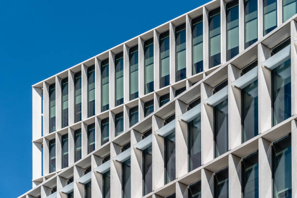 Low angle view of the facade of modern office building stock photo