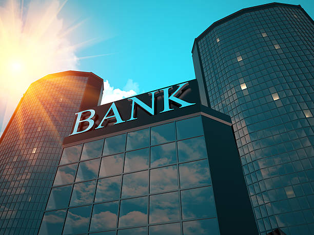 Low angle view of the sun shining over a bank stock photo