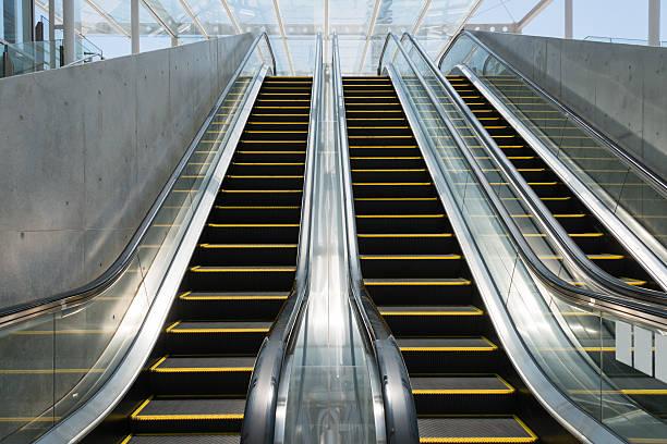 Low angle view of three escalators (XXXLarge) stock photo