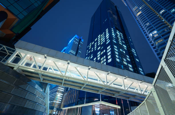 Low angle view of walkway bridge and skyscraper office building stock photo