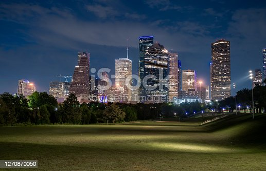 Low Angle View of Wide Open Field With the City of Houston Texas Skyline in the background