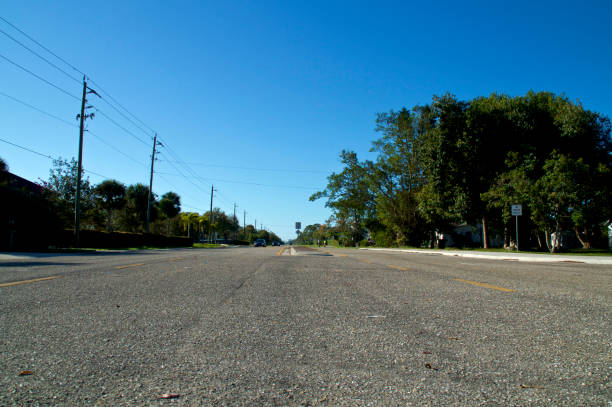 low angle view of wide open road and clear sky stock photo