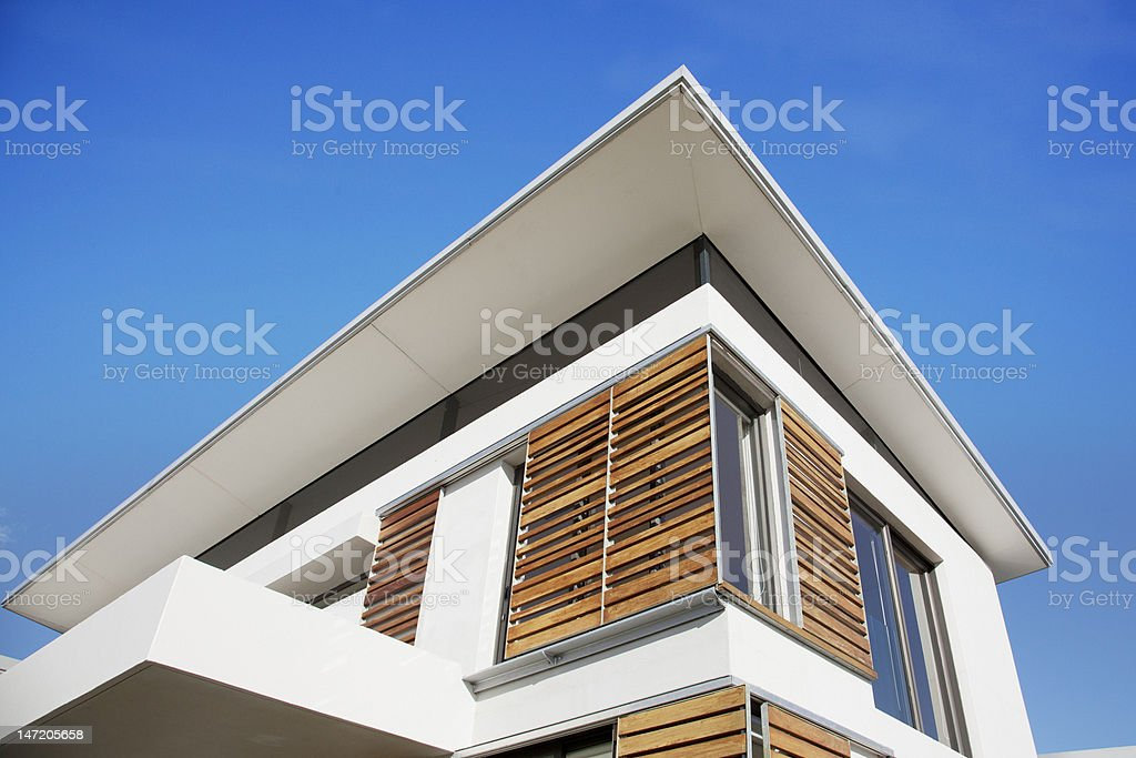 Low angle view of wood shutters on modern house stock photo