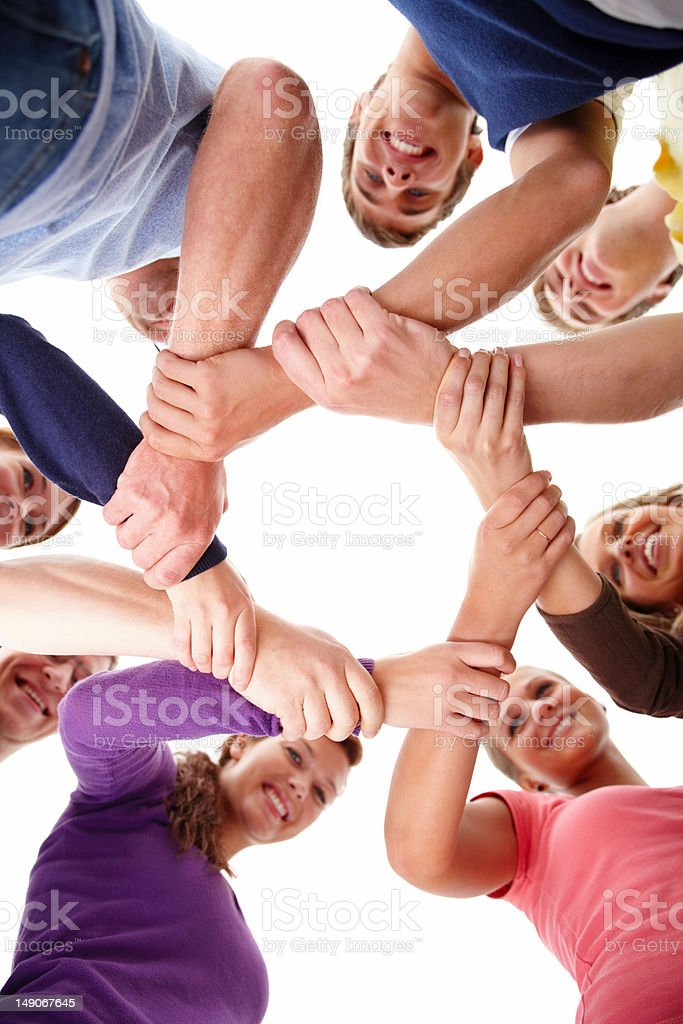 Low angle view of young friends holding wrists royalty-free stock photo