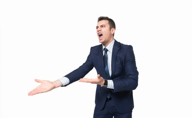 Low angle view portrait of furious young businessman screaming on white background stock photo