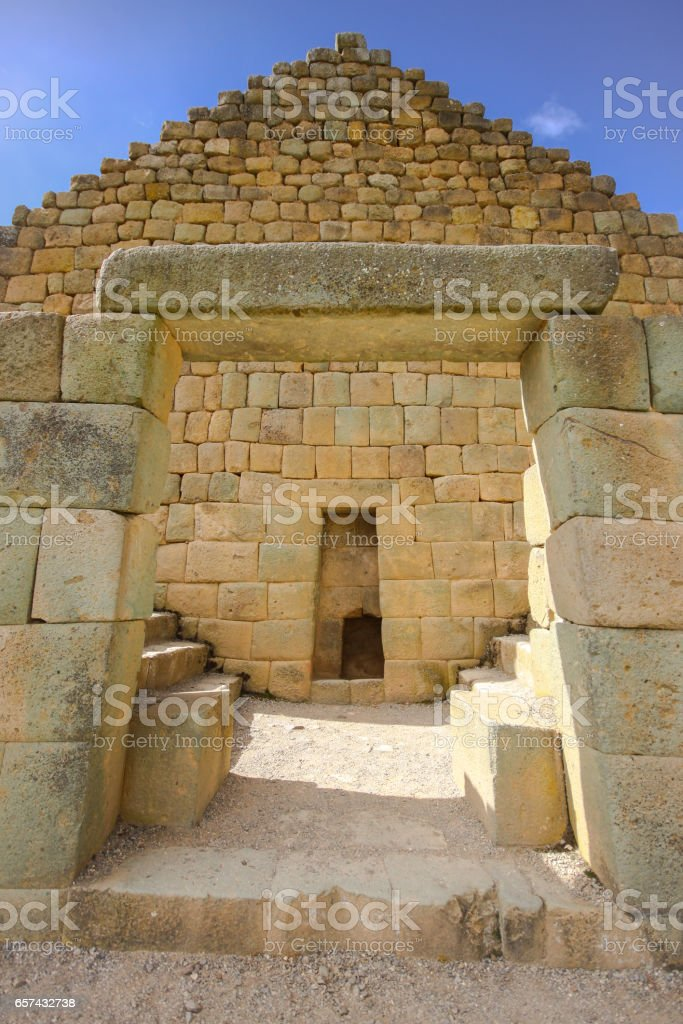 Low angle view to Temple fo the Sun framed of a stone gate, Ingapirca stock photo