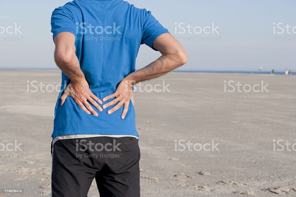 Low back pain stock photo