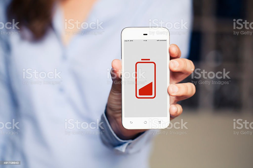 Low battery concept. Woman's hand showing mobile phone screen. stock photo