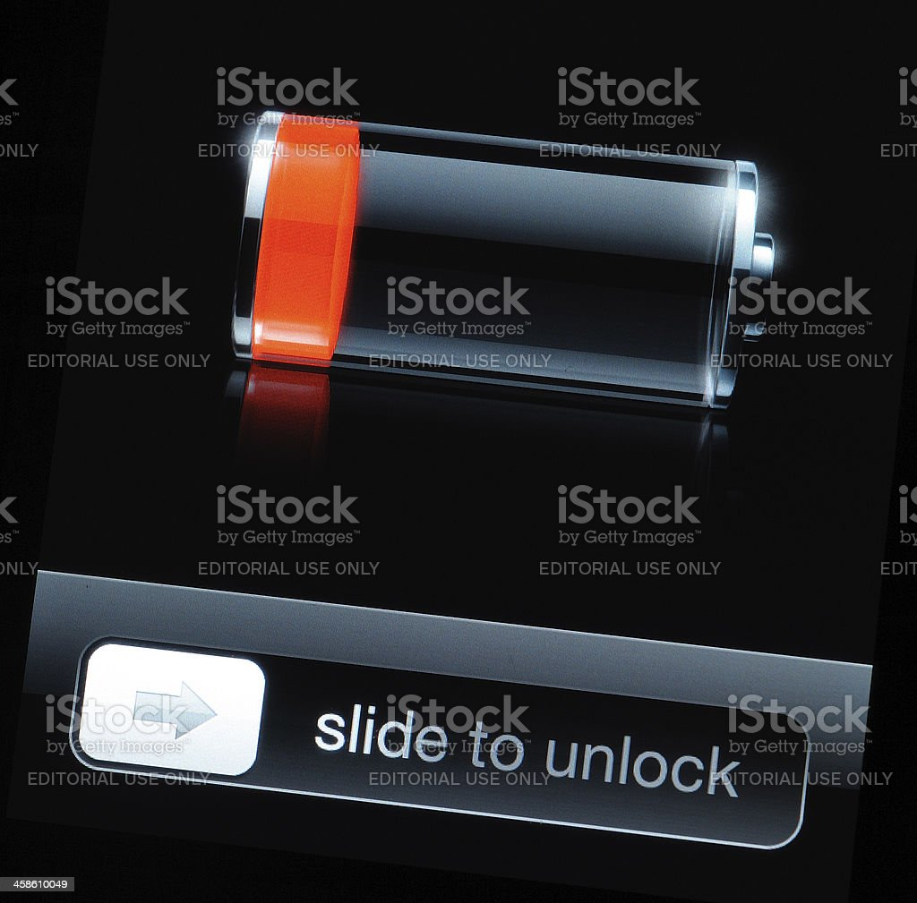 Low battery icon on iPhone screen stock photo