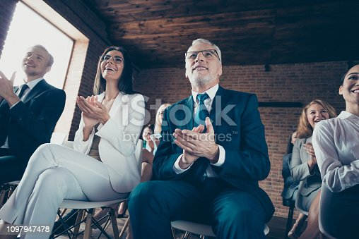 istock Low below angle view of luxurious elegant classy stylish cheerful business people sharks attending financial course management development at industrial loft interior work place station 1097947478