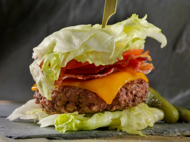 Low Carb - Lettuce Wrap Bacon CheeseBurger Low Carbohydrate - Lettuce Wrap Burger with bacon and cheese bacon cheeseburger stock pictures, royalty-free photos & images
