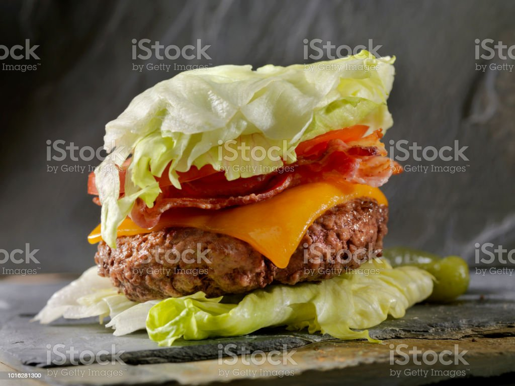 Low Carb - Lettuce Wrap Bacon CheeseBurger Low Carbohydrate - Lettuce Wrap Burger with bacon and cheese Appetizer Stock Photo