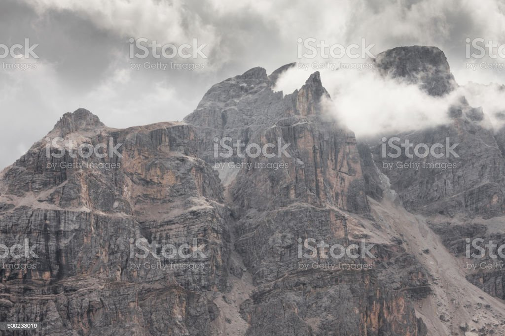 Low clouds among  the Piz Duleda Puez Group peaks in Dolomites area stock photo
