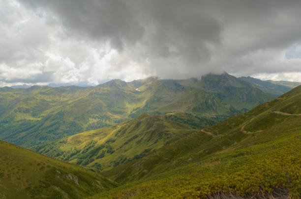 Low clouds over a mountain valley in the Caucasian mountains stock photo