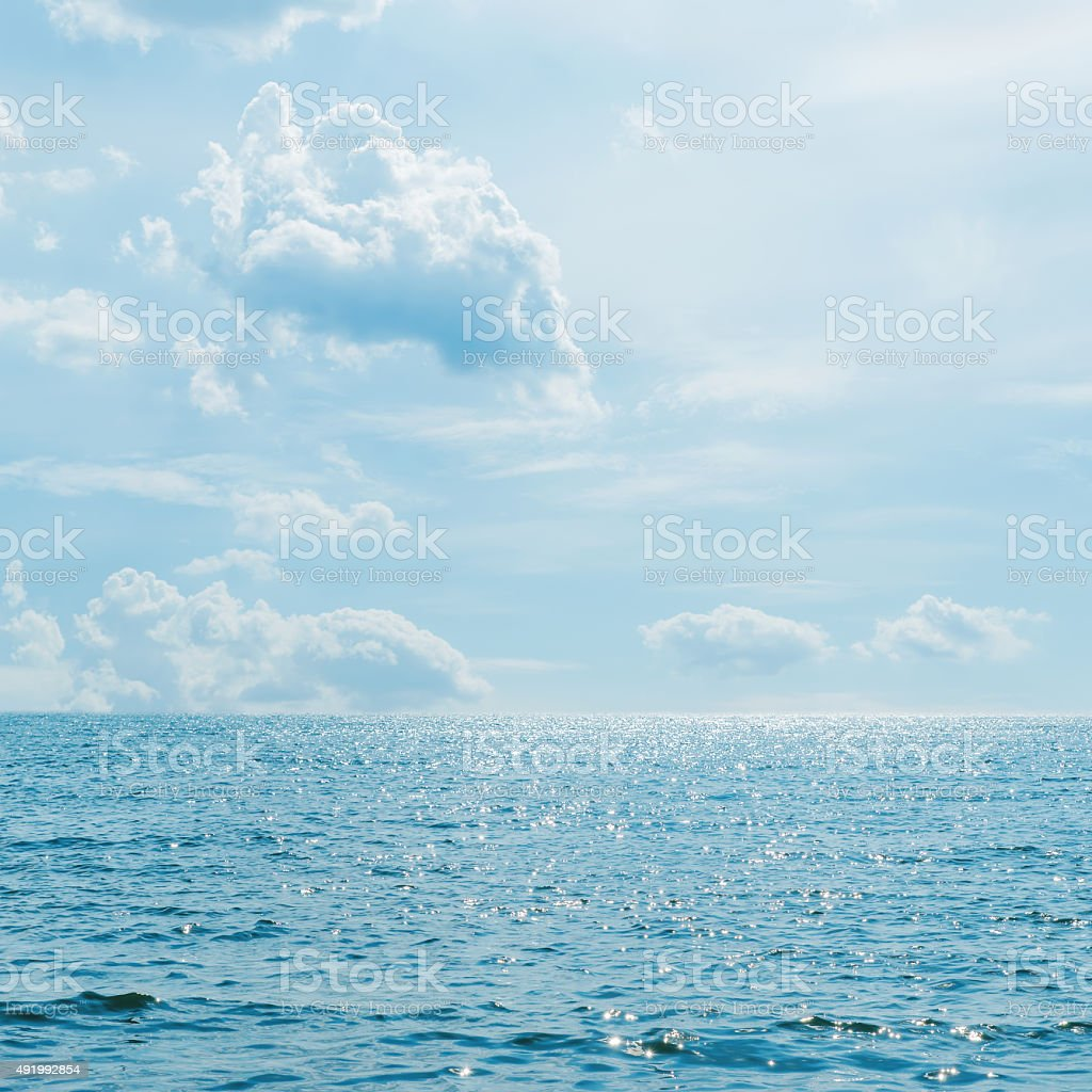 low clouds over sea with wave stock photo