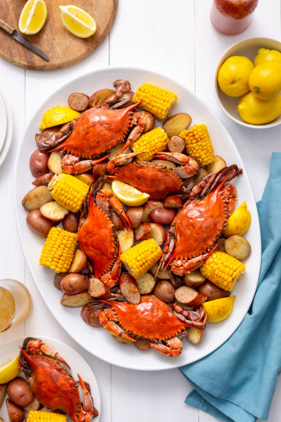 low country blue crab seafood boil with corn, sausage, red potatoes - mphillips007 stock pictures, royalty-free photos & images