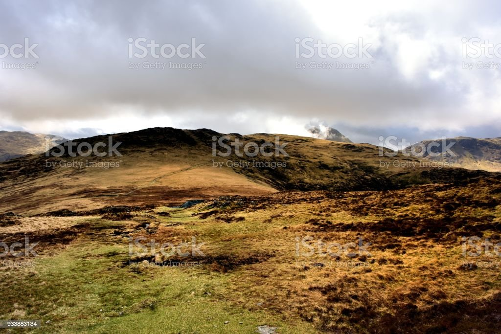 Low dark clouds over Grey Knotts and Brandeth stock photo