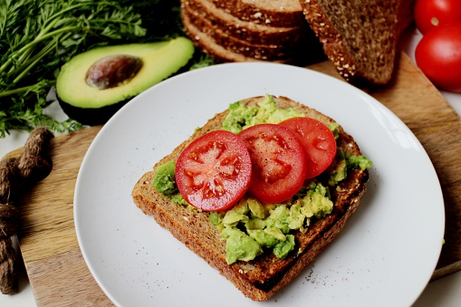 Low GI breakfast toast with avocado and tomato