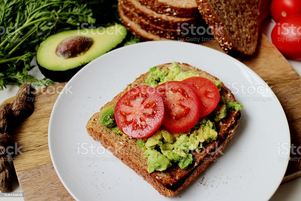 Low GI breakfast toast with avocado and tomato stock photo