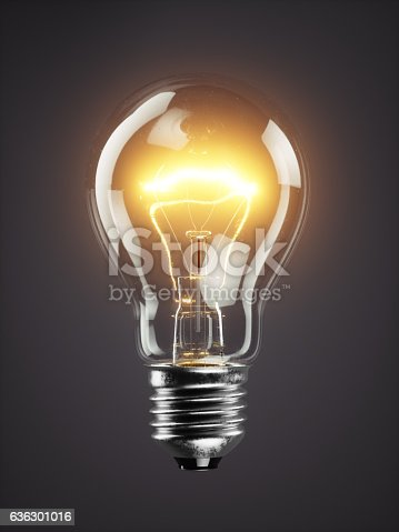 istock Low glowing electric bulb lamp on dark background 636301016
