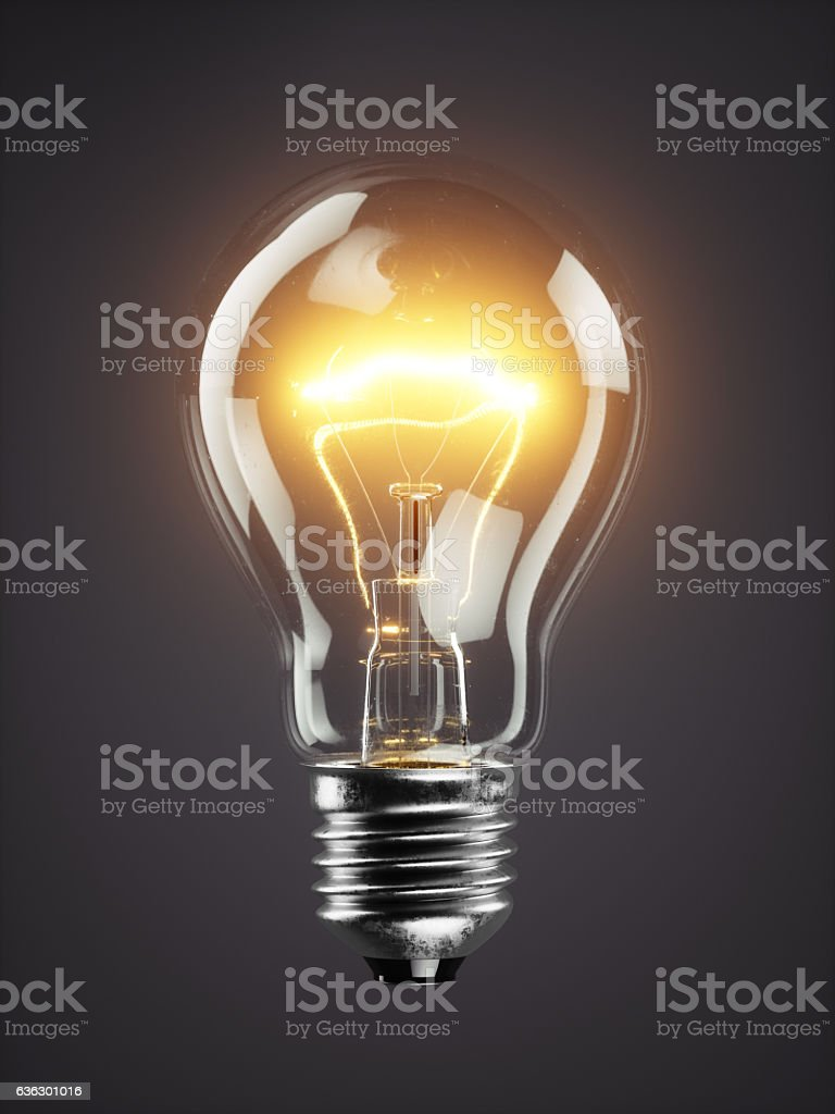 Low glowing electric bulb lamp on dark background – Foto