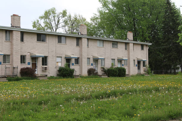 low income housing with unkempt lawn - run down stock pictures, royalty-free photos & images