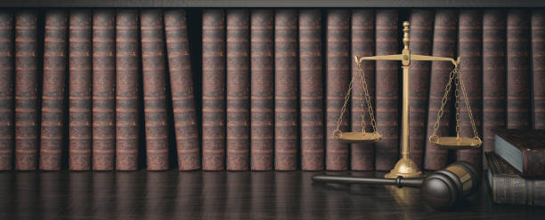 low key filter law bookshelf with wooden judge's gavel and golden scale, 3d rendering - litigation stock pictures, royalty-free photos & images