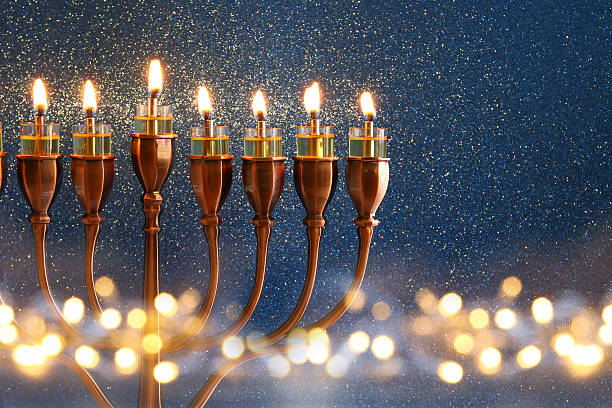 low key image of jewish holiday hanukkah background - chanukka stock-fotos und bilder