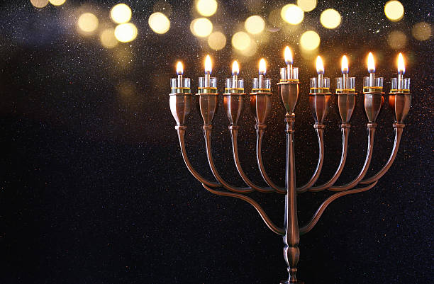 low key image of jewish holiday hanukkah background - hanoukka photos et images de collection