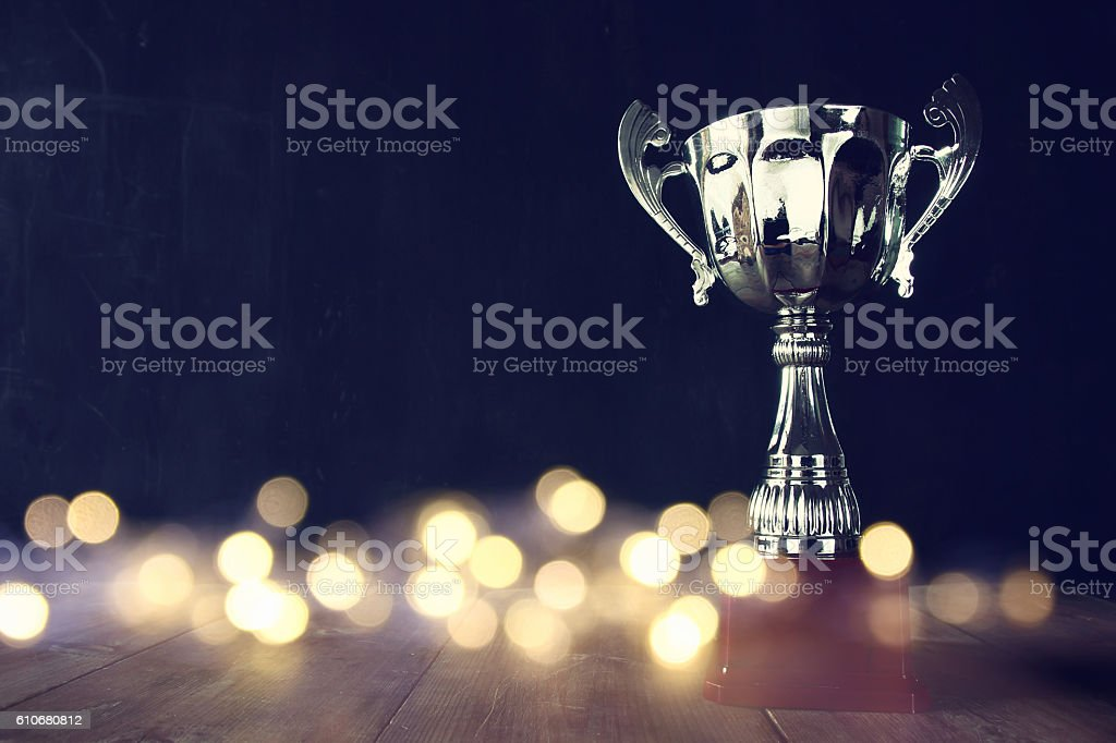 low key image of trophy over wooden table 스톡 사진