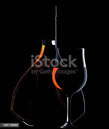 istock Low Key Lit Portrait of Cognac Bottle and Glass 108126592