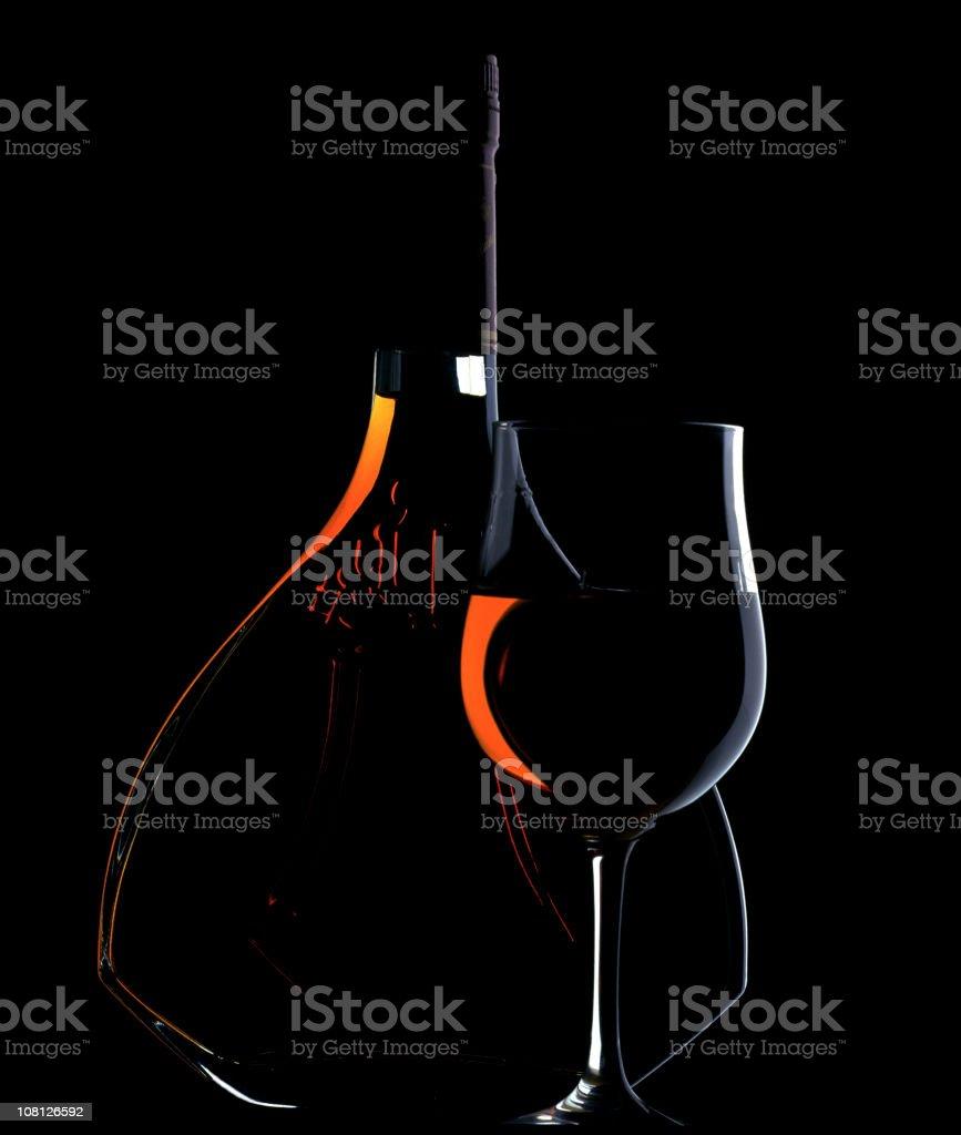 Low Key Lit Portrait of Cognac Bottle and Glass stock photo