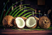 Low key of coconuts on wooden rustic table