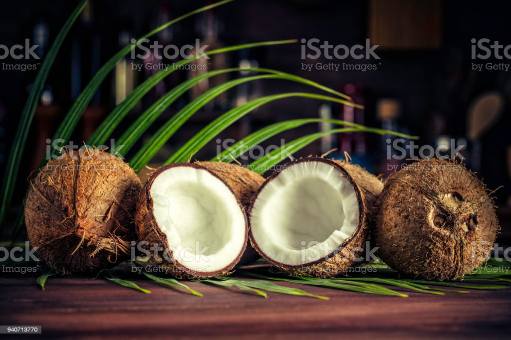 Low key of coconuts on wooden rustic table stock photo