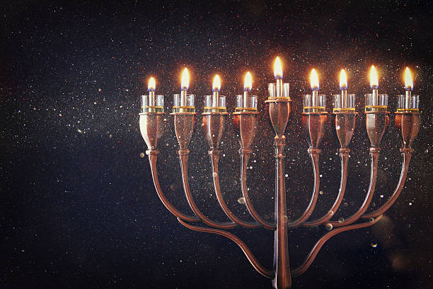 low key of jewish holiday hanukkah background - hanoukka photos et images de collection