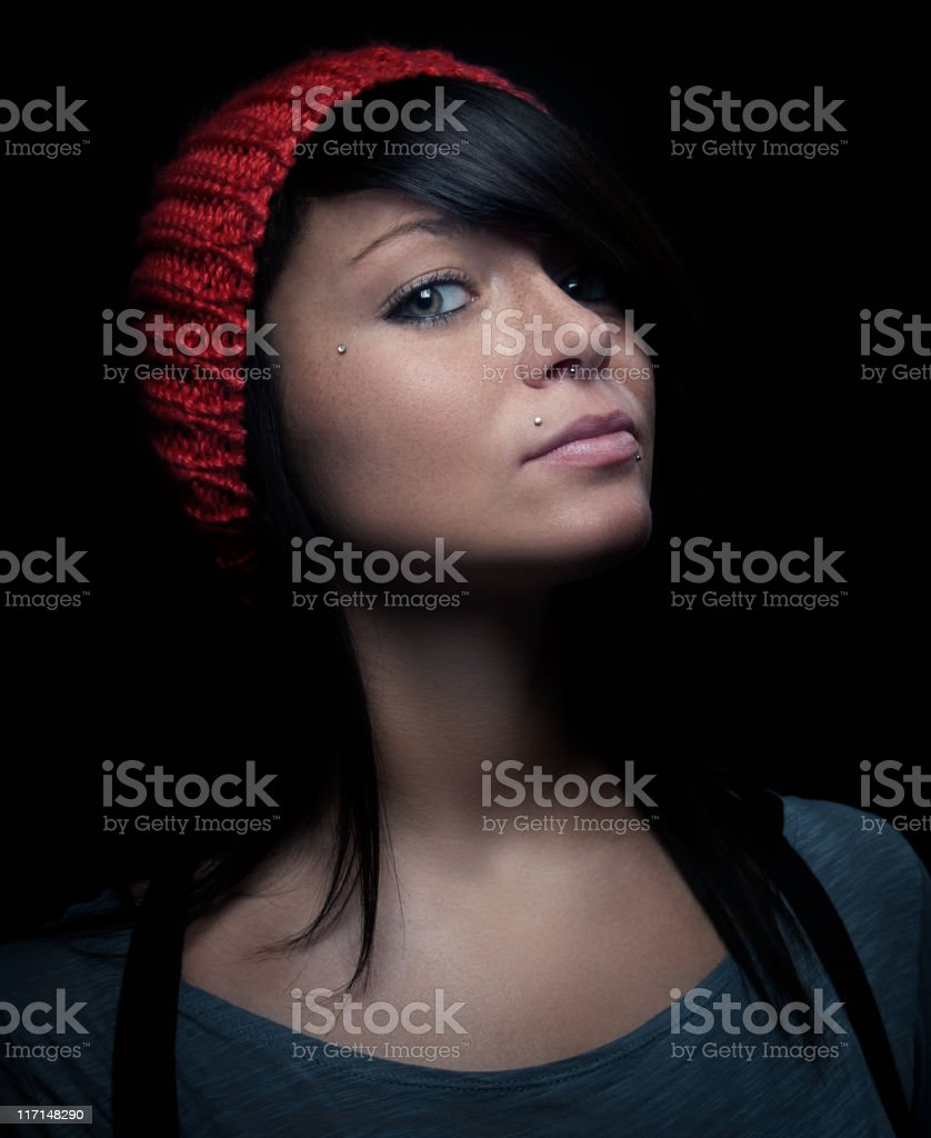 Low key portrait of a pierced woman royalty-free stock photo