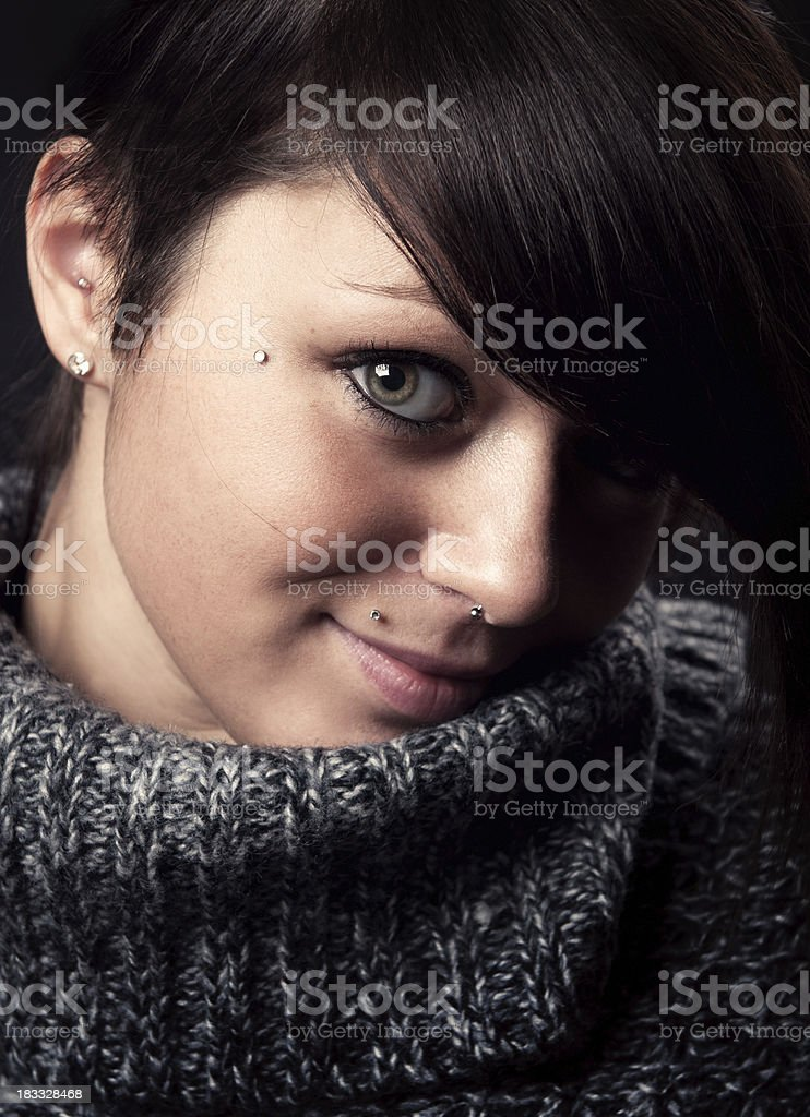 Low key portrait of a pierced woman royalty-free stock photo
