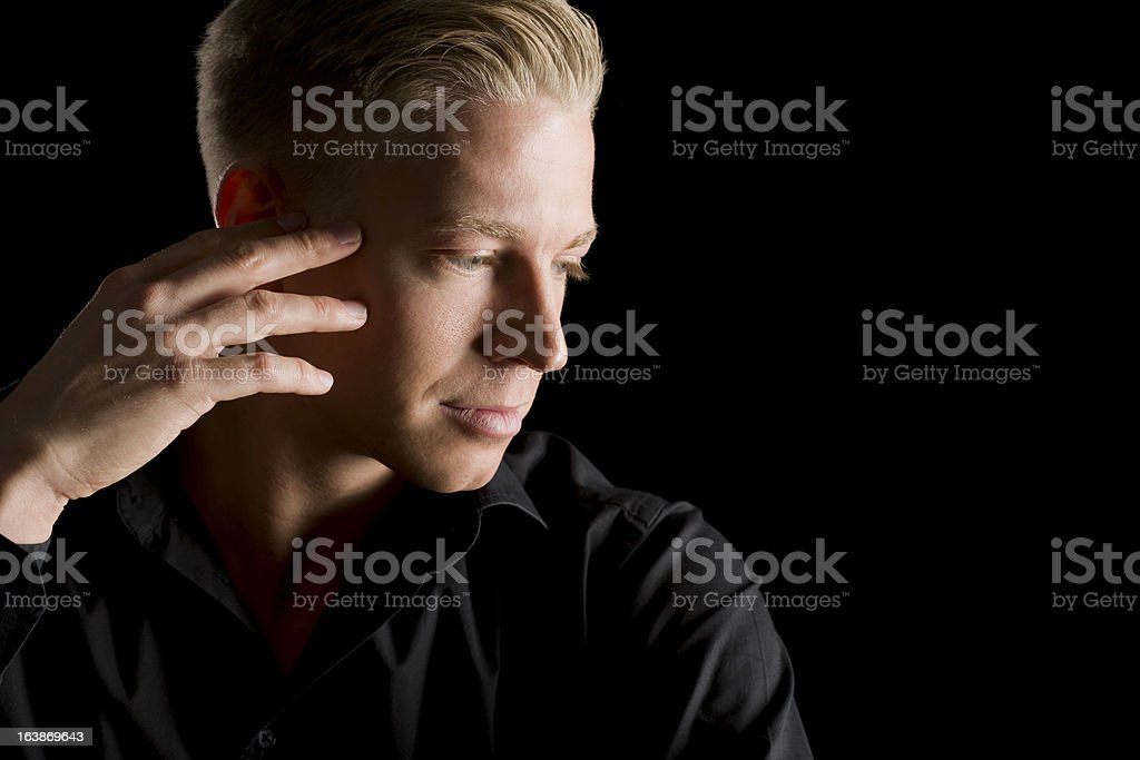 Low Key Portrait Of Handsome Man Looking Aside Stock Photo