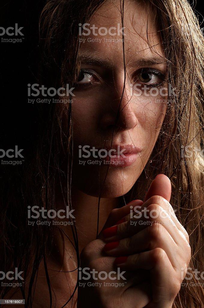 Low Key Portrait of Sad Woman Crying stock photo